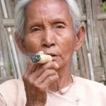 Burmese Woman Smoking Natural Cigar