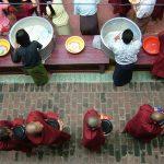 Feeding Monks at Mandalay Temple
